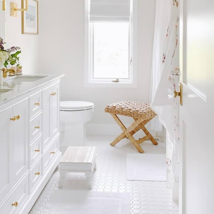 white roman shade in neutral bathroom