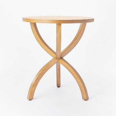 A small natural wood accent table with curved legs from studio mcgee for target