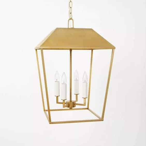 A brass lantern pendant against a white background, from Studio McGee for Target