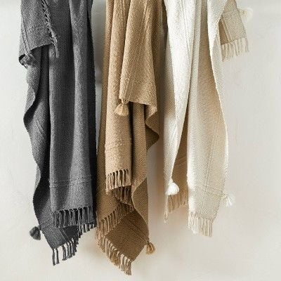 A gray, camel and cream woven throw for a studio mcgee for target product shot