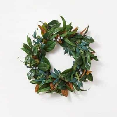a faux magnolia wreath from studio mcgee Target, on a white surface