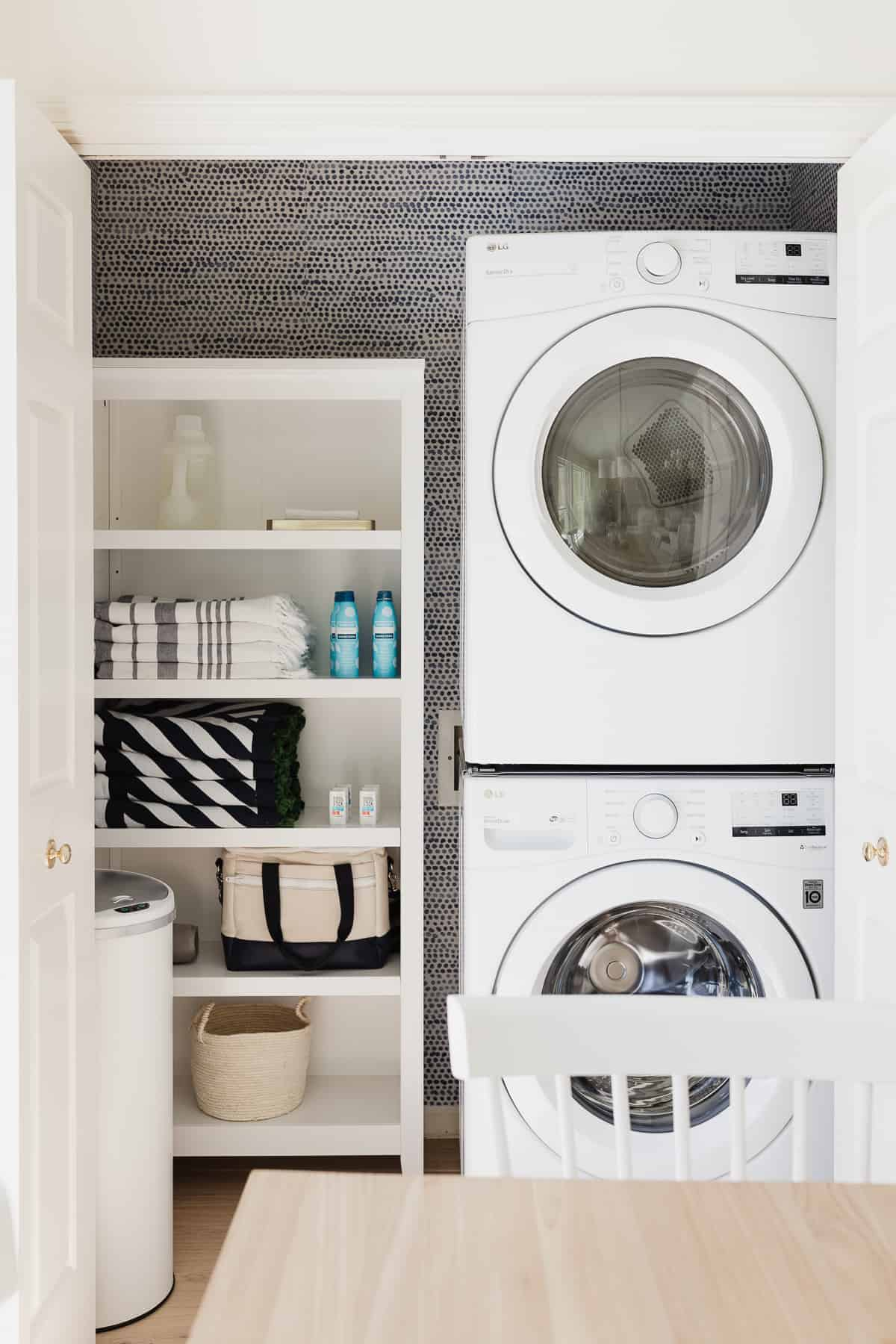 laundry closet with stackable washer and dryer