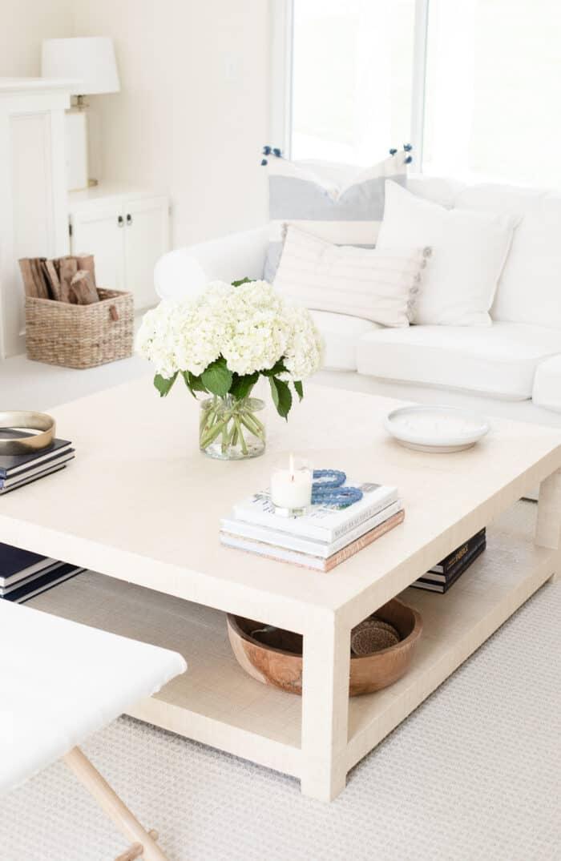 raffia coffee table in white living room