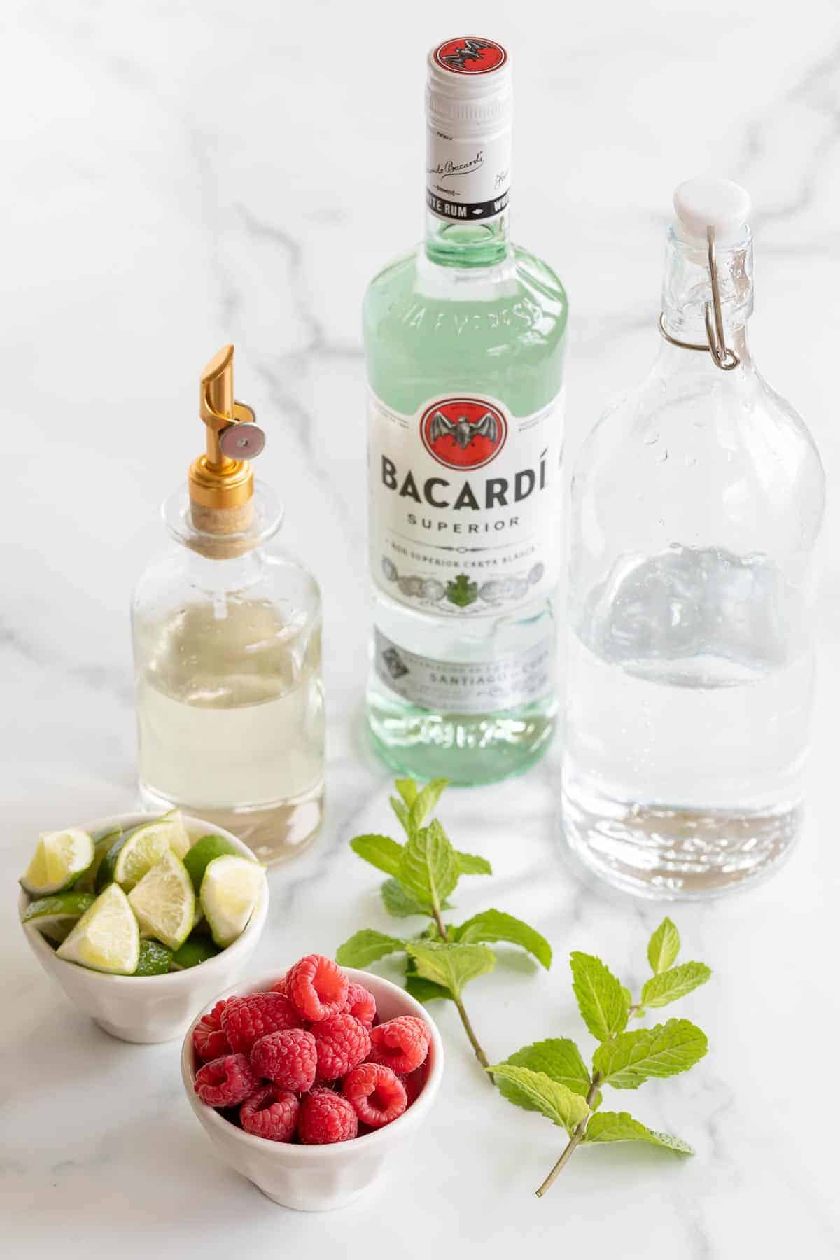raspberry mojito ingredients displayed on marble surface