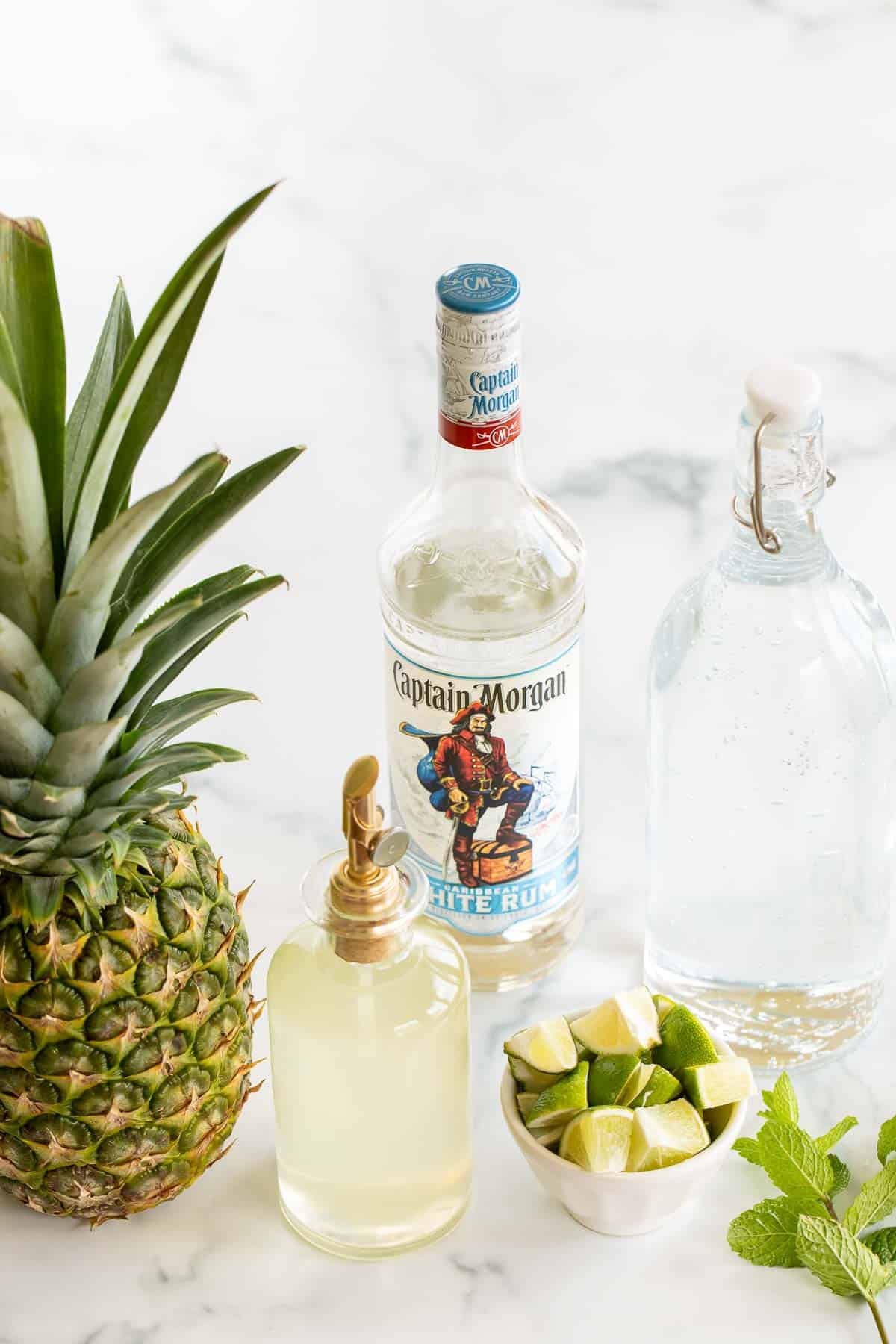 pineapple mojito ingredients displayed on marble surface