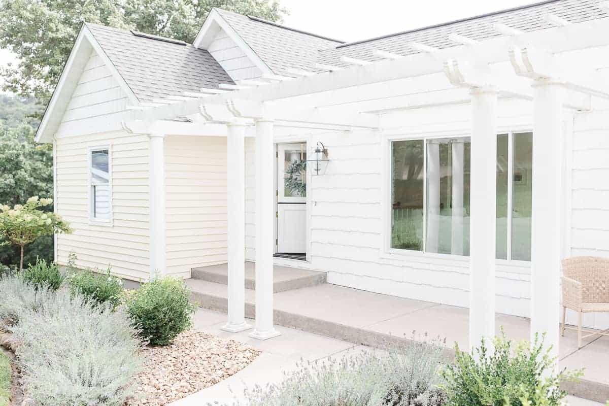 ranch house with pergola lavender and boxwood