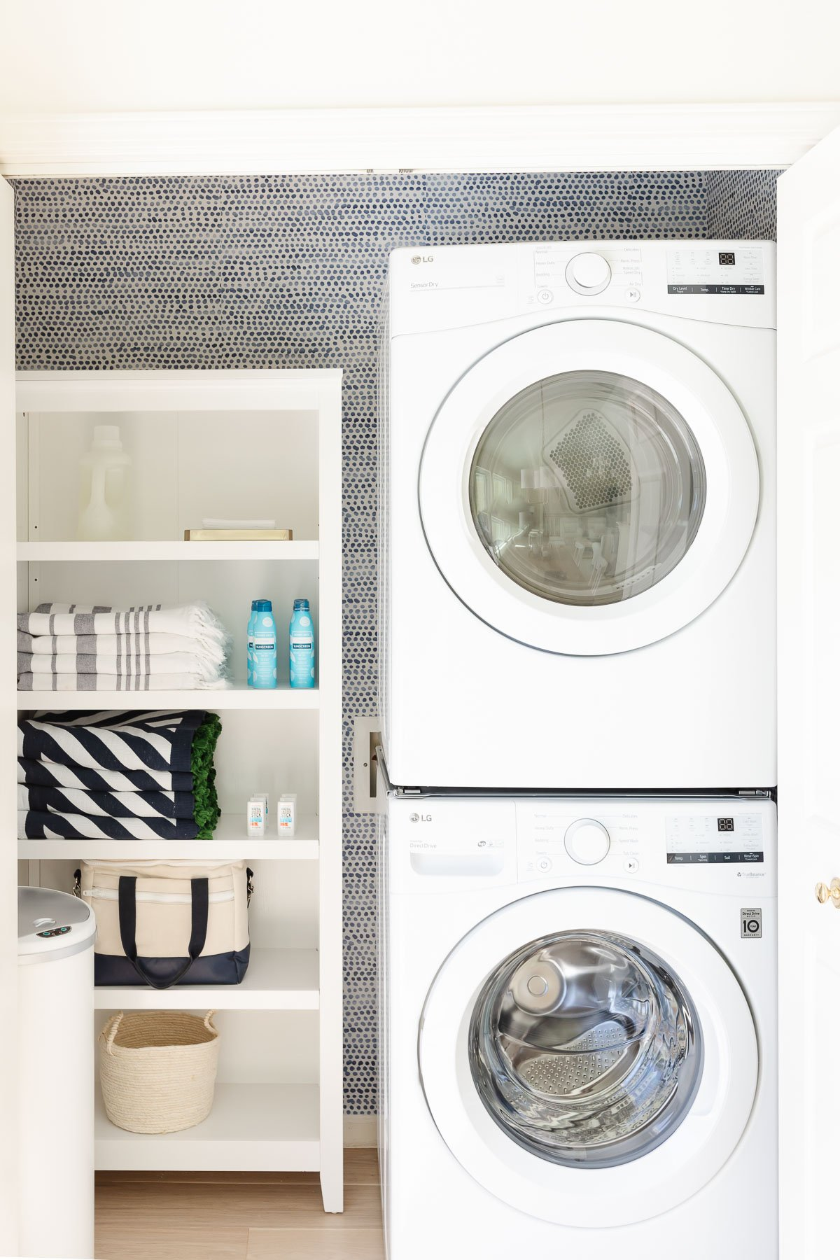 rubbish from shelves and stacked washing machines and dryers in the closet