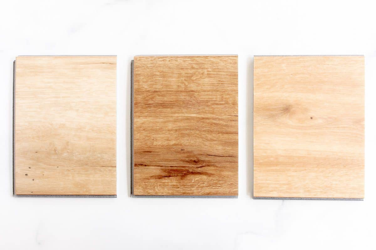 Small samples of the best vinyl plank flooring laid out on a white surface.