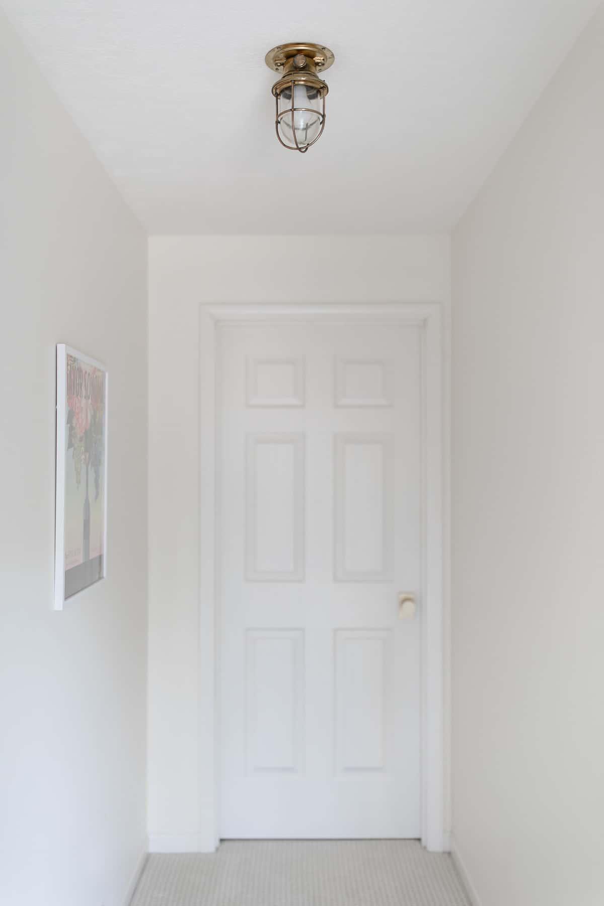 brass nautical light in hall