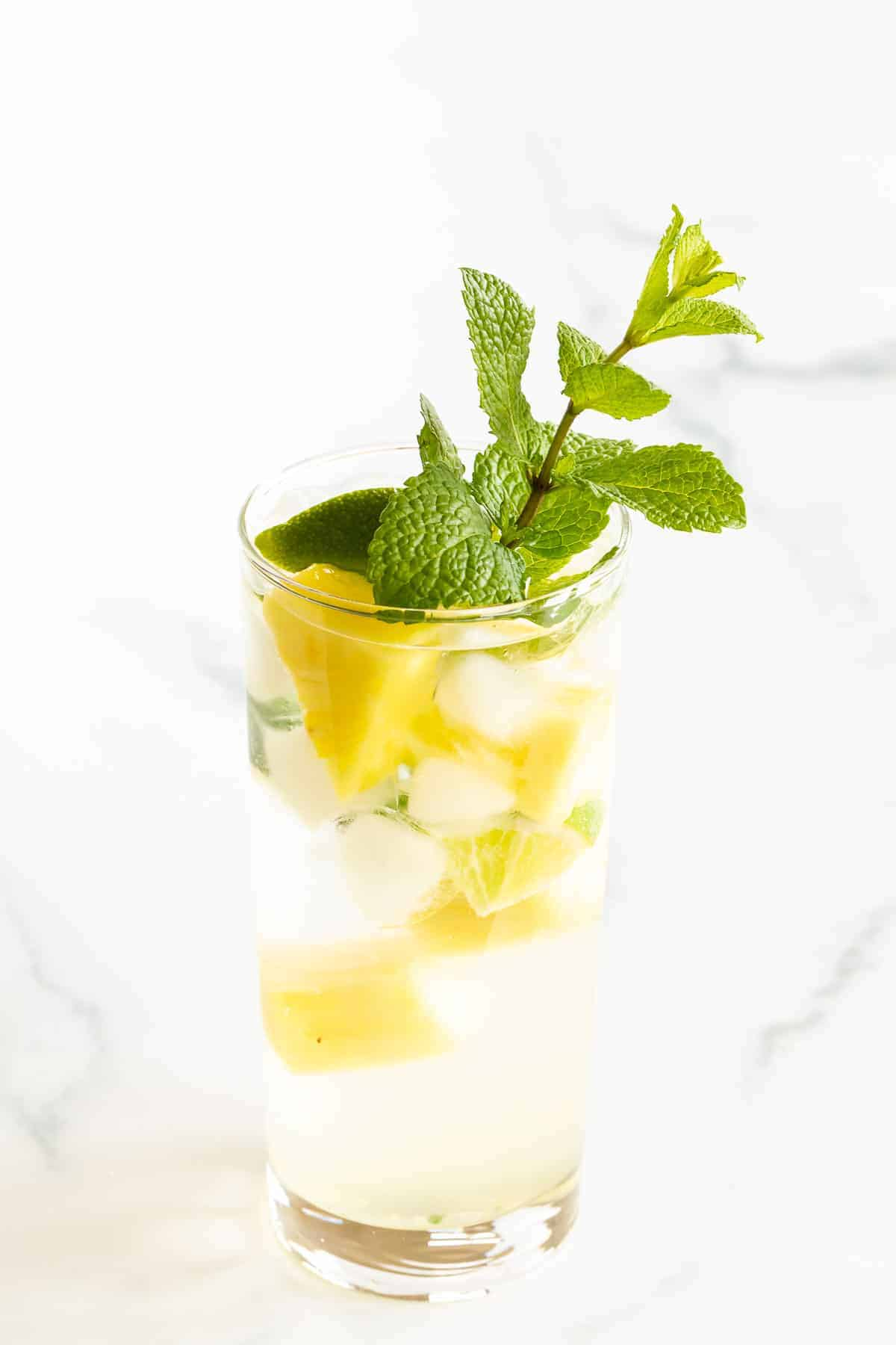 mojito with pineapple and mint in clear glass