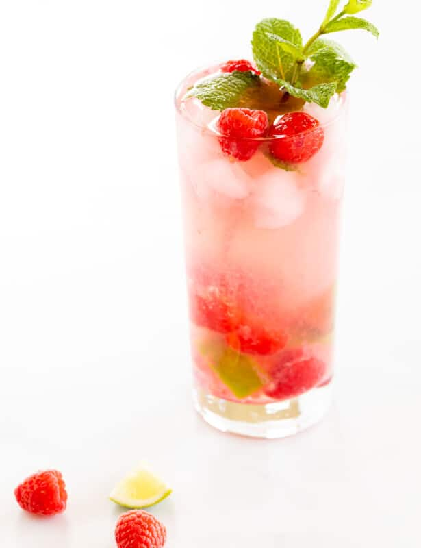 raspberry mojito with limes and mint sprig