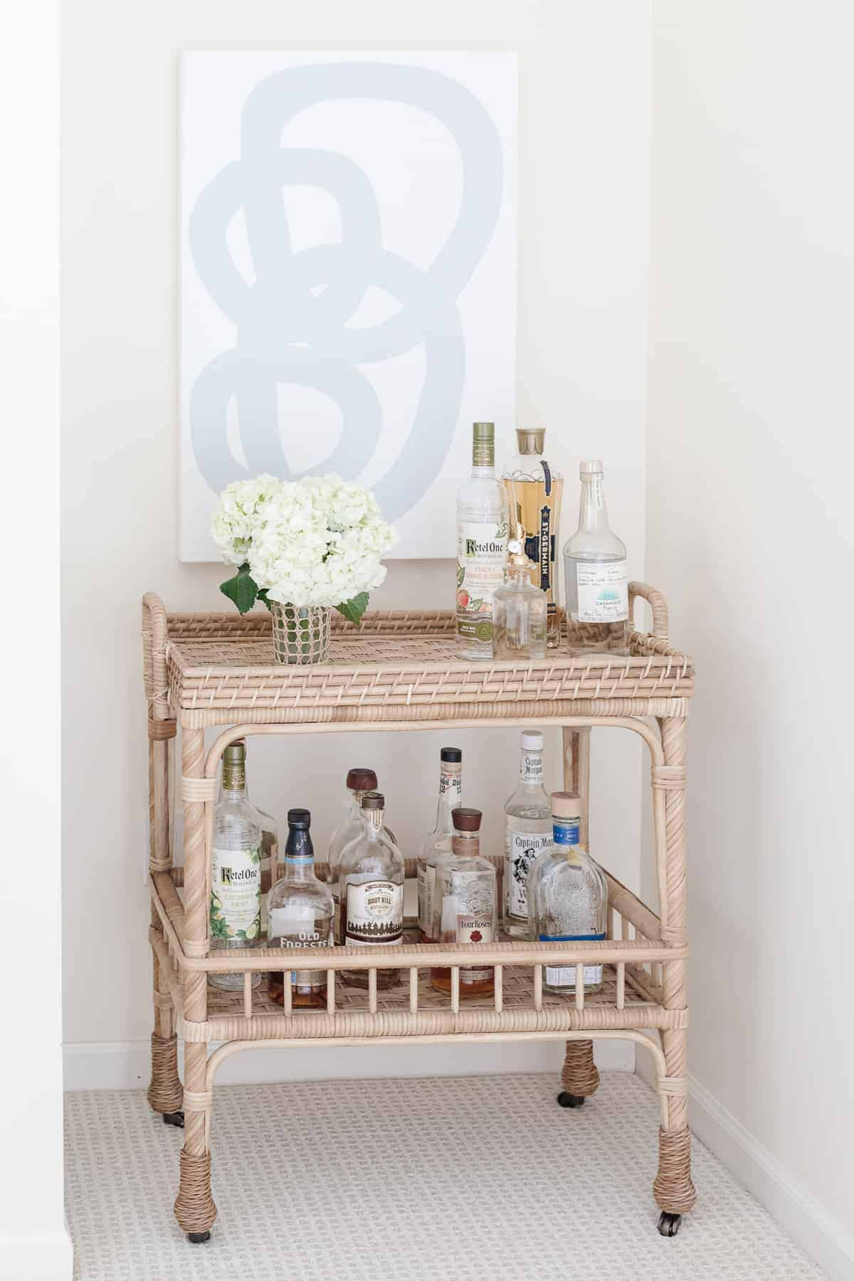 rattan bar cart with painting over