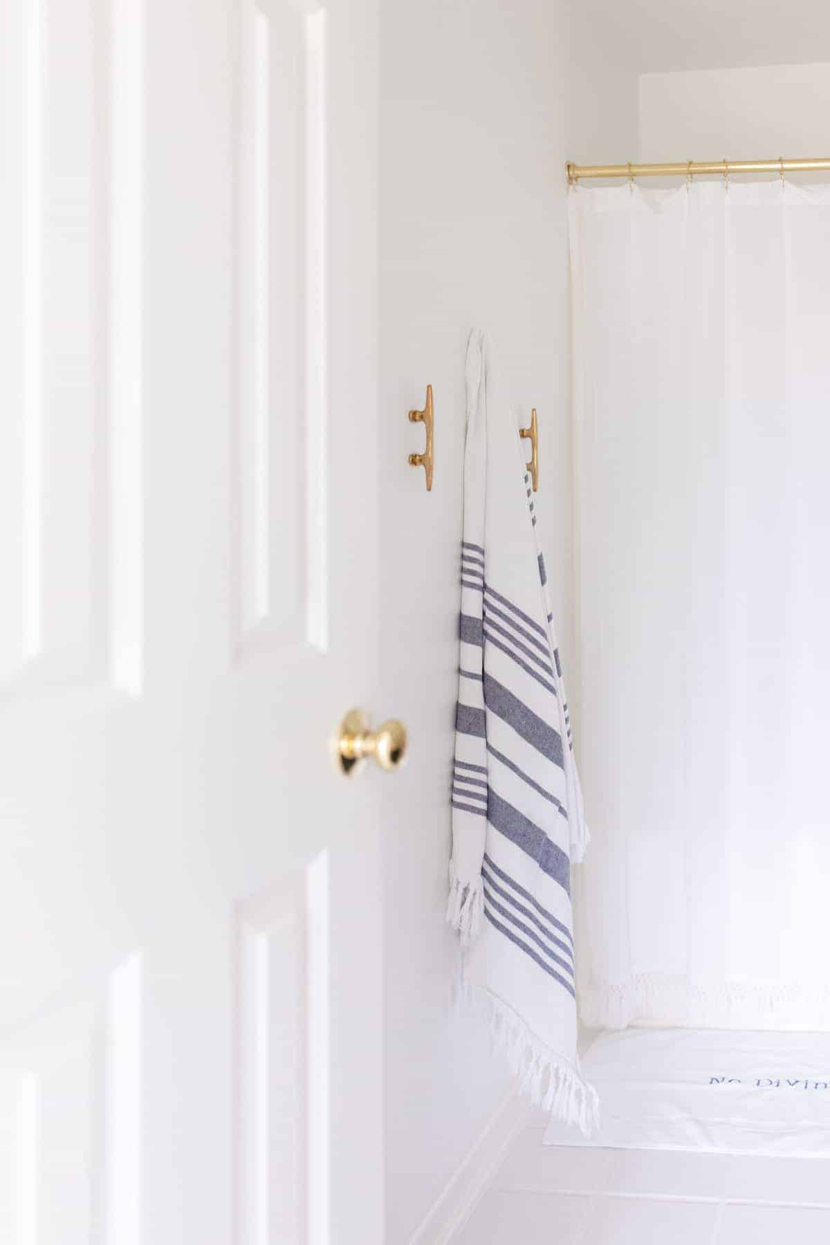 bathroom with brass boat cleat towel hanger