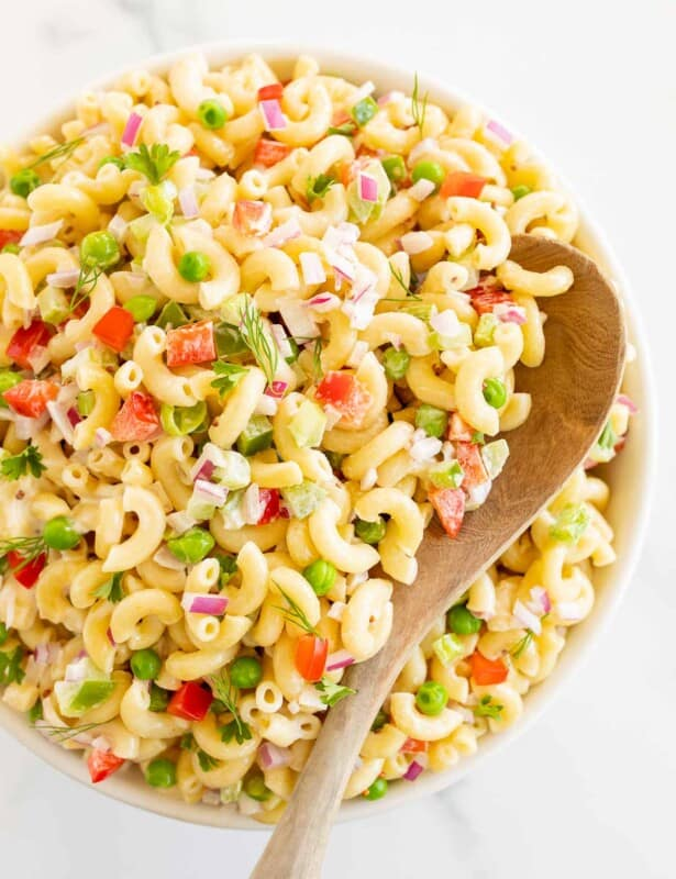 bowl of pasta salad with wood spoon