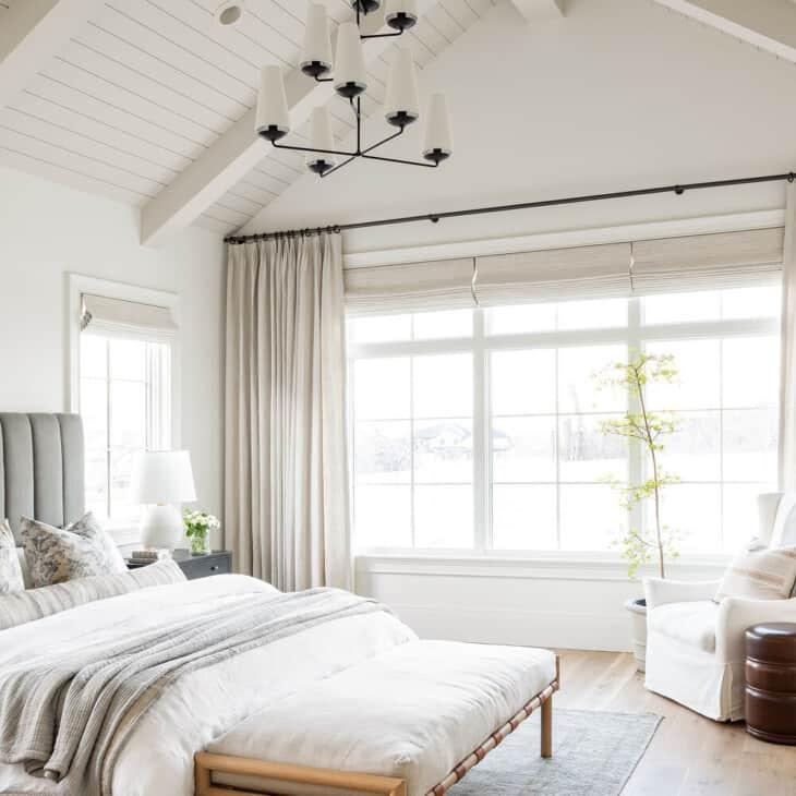 bedroom with vaulted ceilings painted in benjamin moore swiss coffee