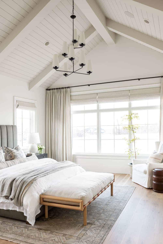 bedroom with vaulted ceilings painted in Swiss coffee by Benjamin Moore