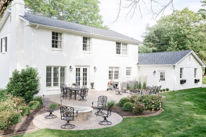 The back of a white brick house painted in Simply White paint from Benjamin Moore.
