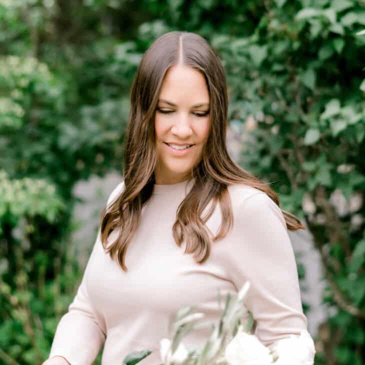 julie blanner holding bucket of flowers