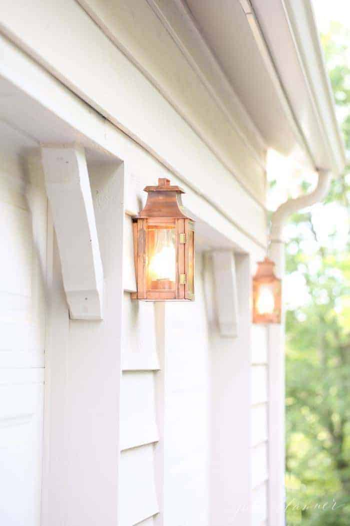 Exterior copper lanterns on a cream painted home.