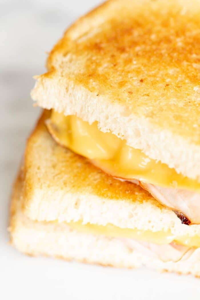 sliced grilled ham and cheese on white bread.