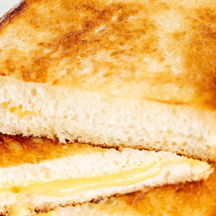 A stack of sliced mayo grilled cheese sandwiches