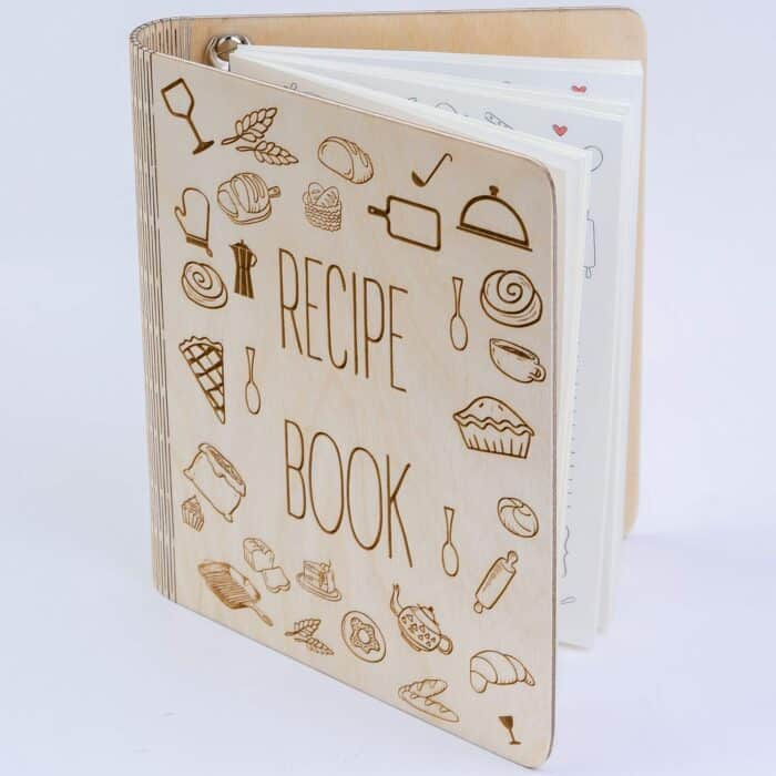 a personalized recipe book with a wooden cover