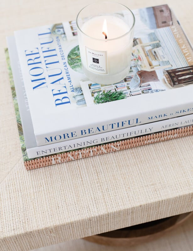 stack of coffee table books on a coffee table