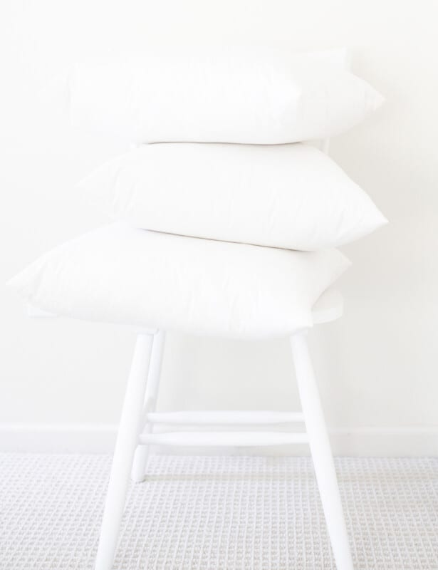 pillow inserts stacked on a chair