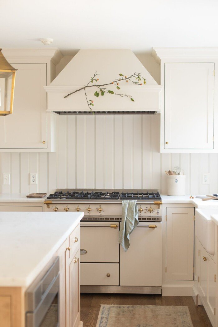 A cream kitchen with a french range and a drawer microwave in island