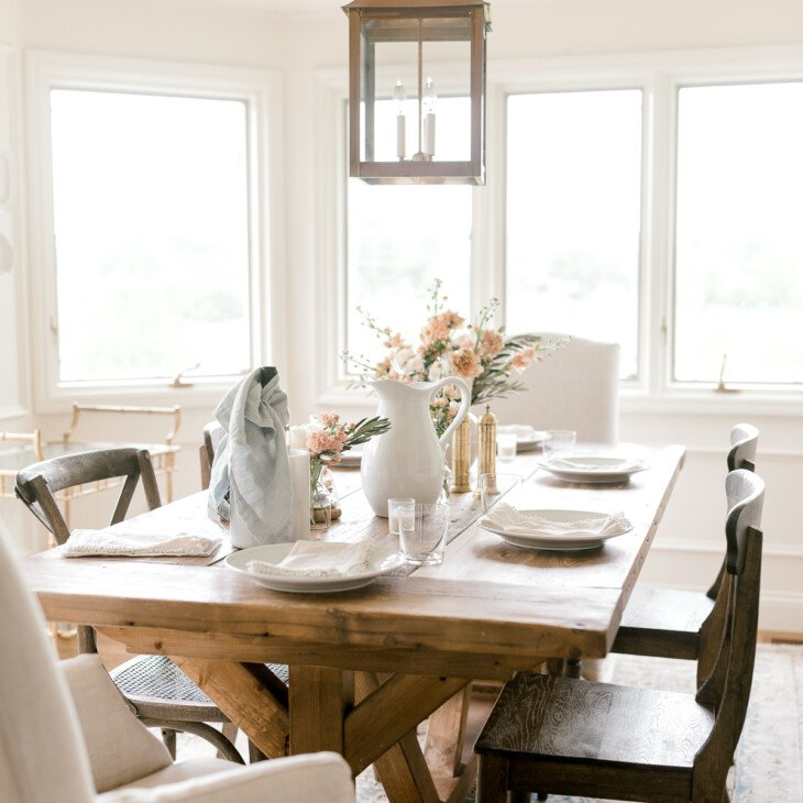 breakfast room with wood table and brass light