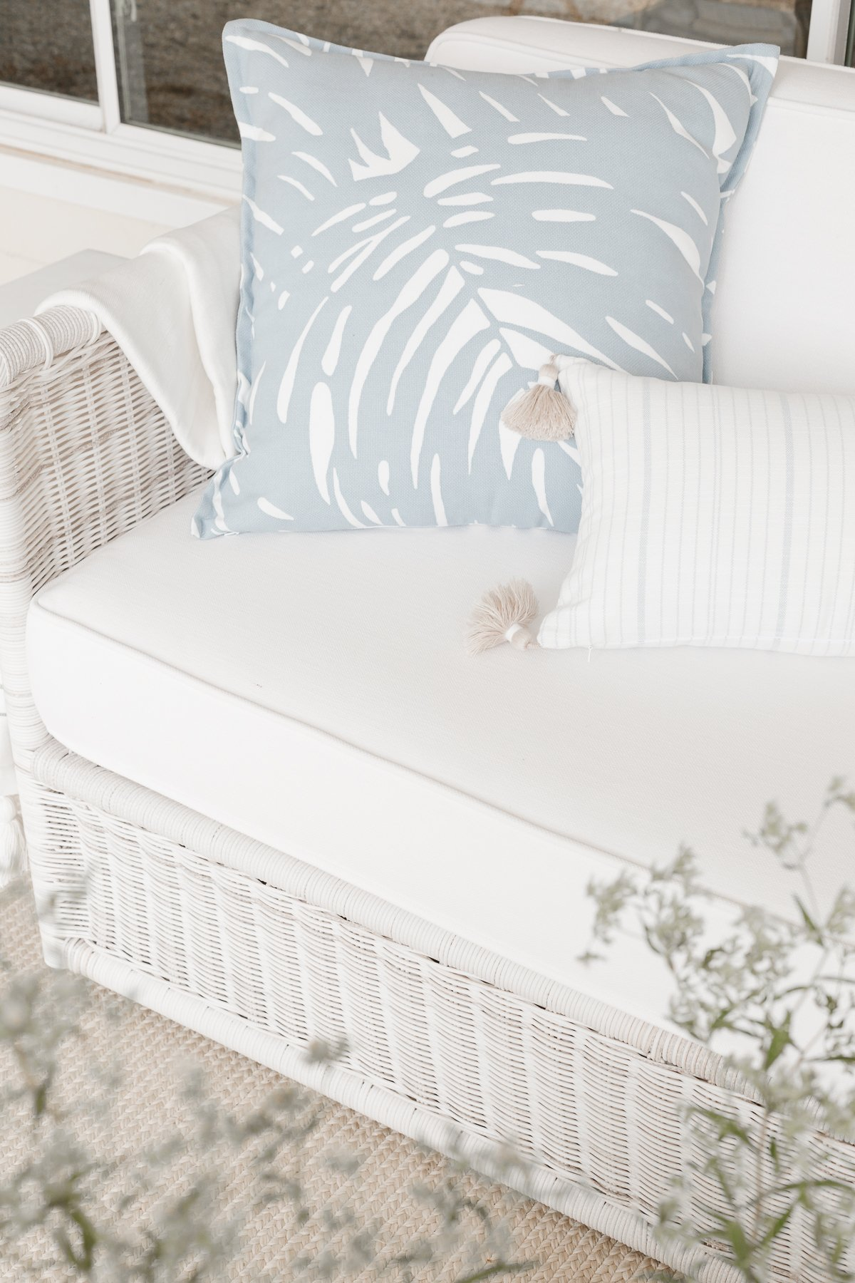 closeup of wicker sofa with pillows