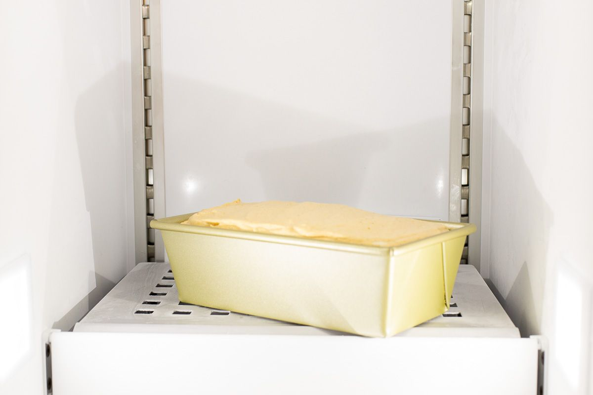 A loaf pan full of no churn ice cream inside a freezer.