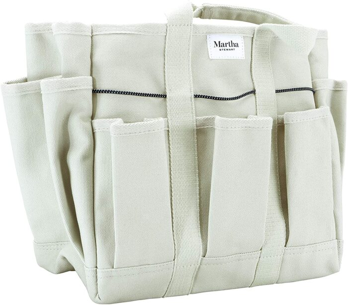 A beige canvas gardening bag for gardening tools