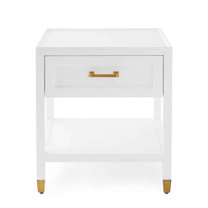 white nightstand with brass feet and pull