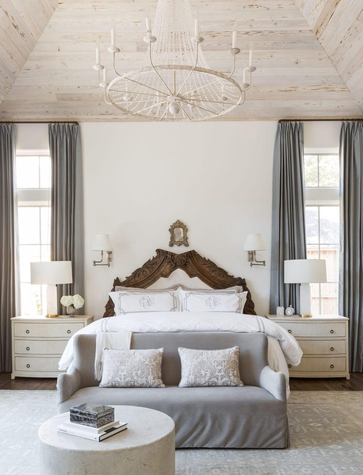 A European-inspired bedroom with walls painted cloudy white by Benjamin Moore