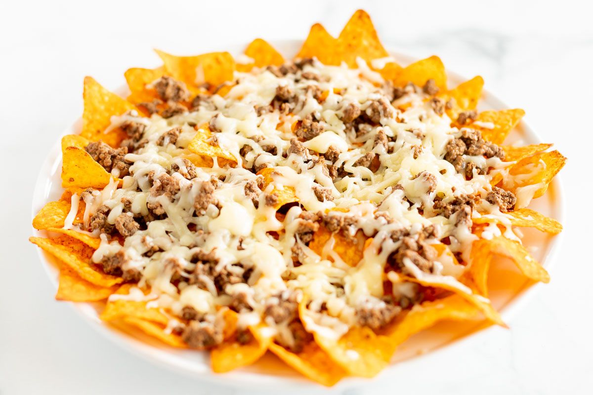 Doritos nachos with ground beef, topped with melted cheese